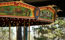 Detailed decorations and painting on an old carrousel.