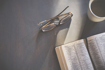 reading glasses and an open Bible