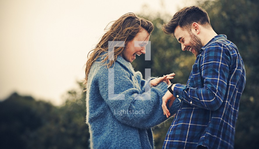 A young couple excited about getting engaged to be married.