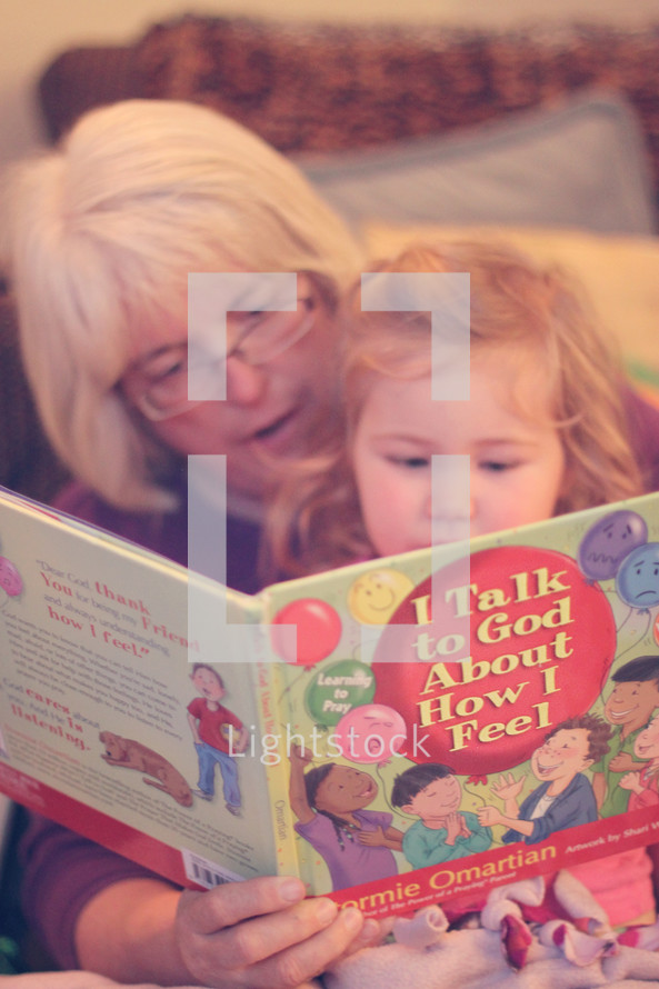 grandmother reading to her granddaughter