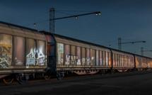grafiti on train cars at night