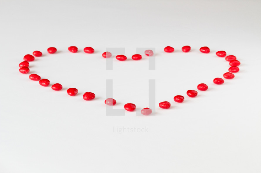 red hot heart candies in the shape of a heart