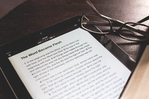 Bible verse on an iPad and reading glasses