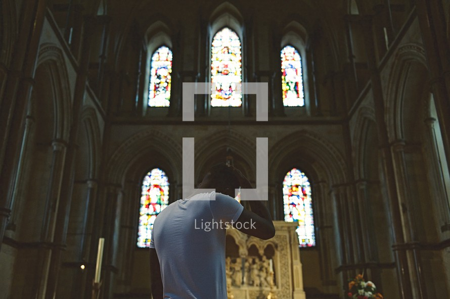man standing in front of an altar ashamed