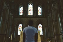 man approaching an altar in a church