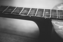 strings on the neck of a guitar