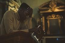 man at a pulpit seeking forgiveness