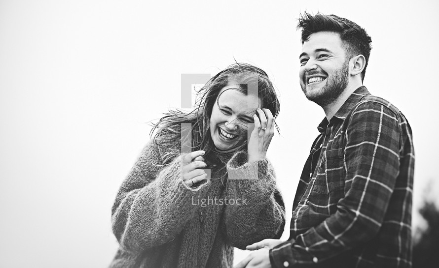 A happy couple laughing together.