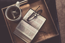 Tea, Bible, and reading glasses on a tray