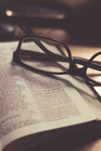 Bible and reading glasses on a tray