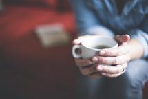 a woman holding a mug of coffee