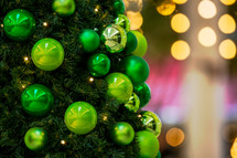 lime green ornaments on a Christmas tree