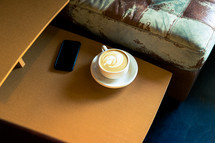 a latte on an end table