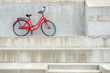 parked red bicycle