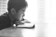 boy child reading a Bible