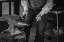a man shaping metal