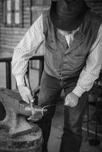 ironsmith shaping metal