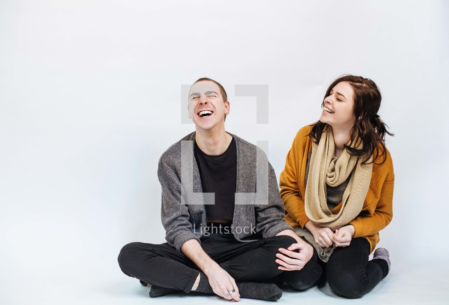 man and a woman laughing