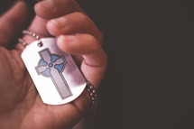 A cross on a dog tag.