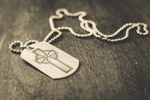 A dog tag with a cross