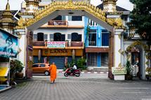 Buddhist monk walking down a street