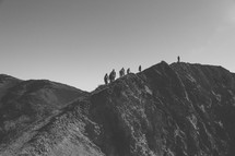 hikers hiking up a mountain