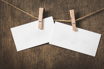 blank note cards hanging on a twine with clothespins