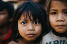 faces of young girls in a village