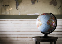 world map and a globe on a table