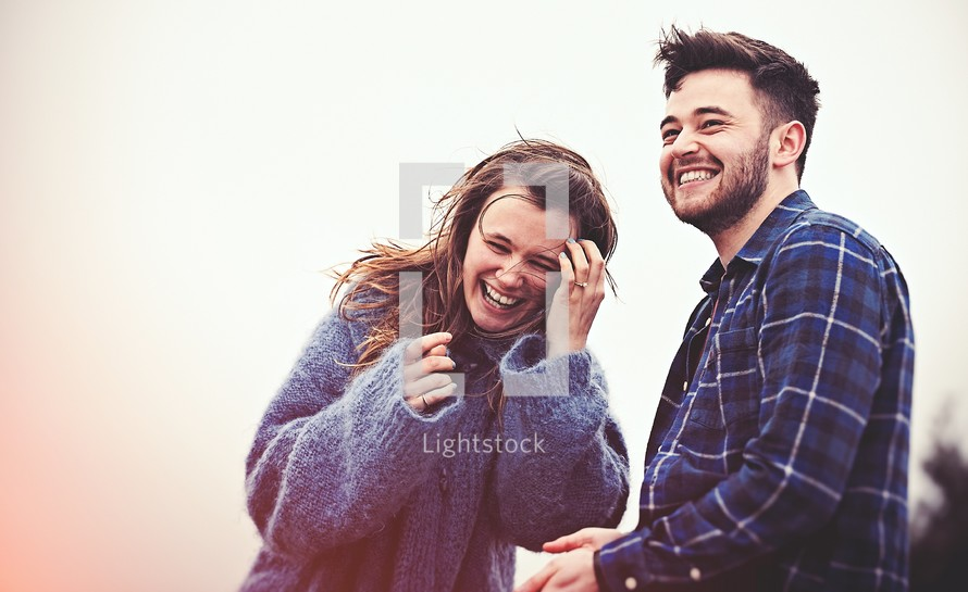 A happy, laughing man and woman.