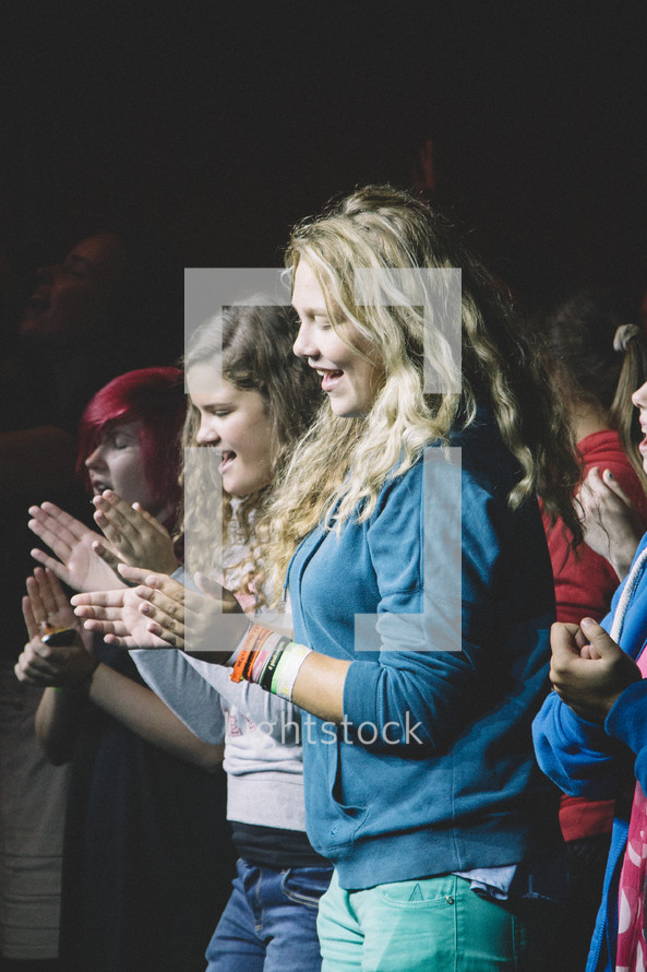 women clapping hands and singing