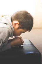 A boy in prayer