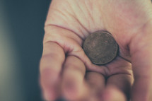 hand holding an ancient coin