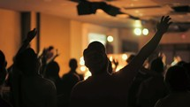 raised and waving hands at a worship service