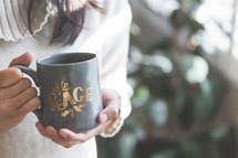 a woman holding a Christmas mug