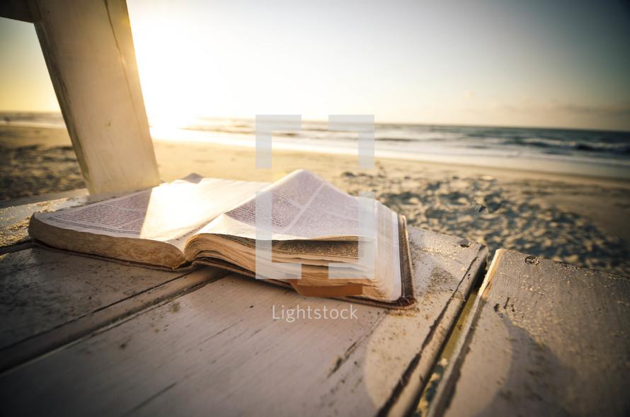 open Bible on a beach