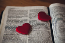 Candy hearts on the pages of a Bible