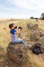 boy child with binoculars