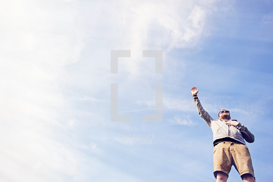 a man with hand raised in the air