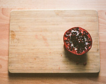 pomegranate on a cutting board