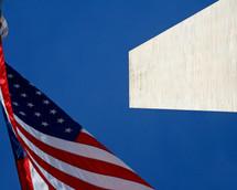 American flag on a flagpole against a blue sky
