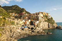 colorful homes on the cliffs of an Italian shore