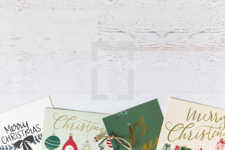 Christmas cards on a white wood background