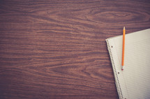 notebook and pencil on a desk