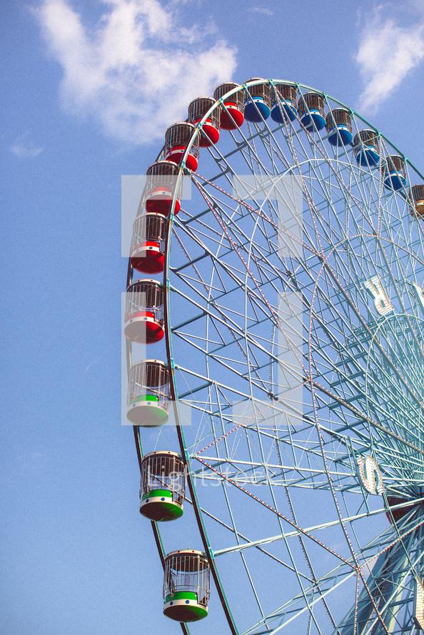 ferriswheel against blue sky