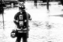 Fireman standing in water,