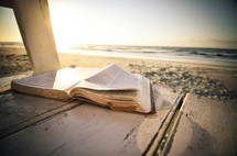 open Bible on a beach