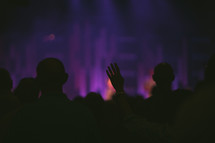 raised hands and congregation in song