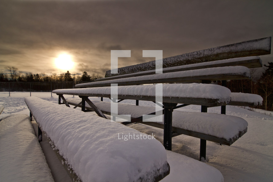 snow on bleachers