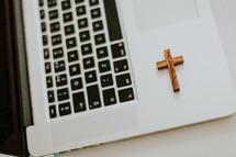 wooden cross on a laptop computer